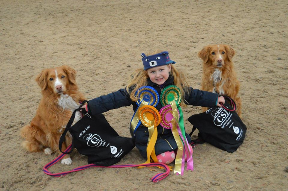 Little girl with Tollers 25.5.16